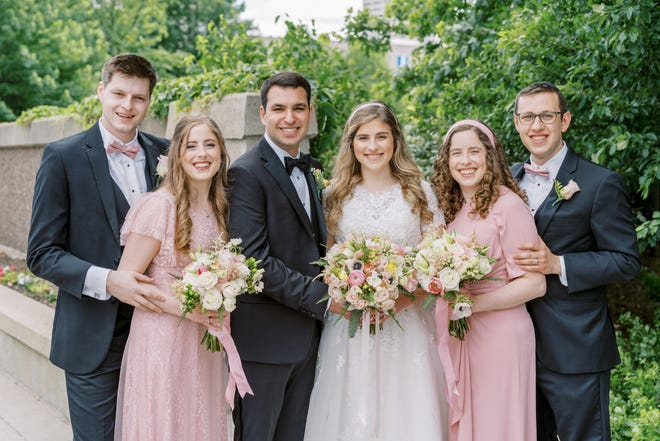 Left to right, Julie and Yari Garner, Ellie and Justin Hod, and Aliza Chase and Akiva Schick