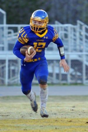Southwestern Randolph quarterback Keaton Reed runs for yardage during the spring 2021 season. [Mike Duprez/Courier-Tribune]