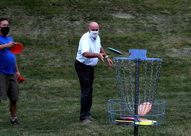 """Disc golf is a lot like regular golf except the """"hole"""" is usually a wire basket."""