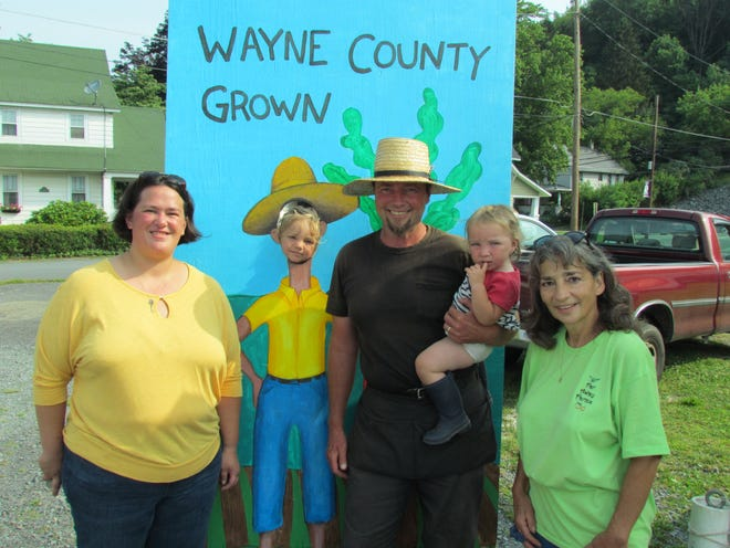 Friendly faces and fresh food await keen shoppers every Saturday from 9:30-12:30 at the Wayne County Farmers Market in Honesdale. Pictured left to right: Sarah Canfield, Angus Fox, Brian Fox, Agathe Fox and Anita Avvisato.
