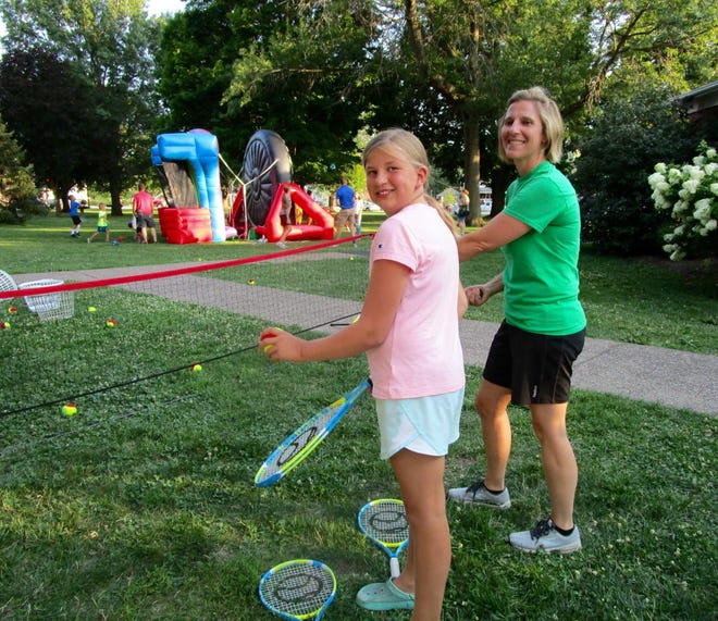 """Hannah Wildemuth, left; and Kate Reed, representing the Geneseo Community Tennis Association, are shown at the badminton net at National Night Out held Tuesday, Aug. 3, in City Park. Reed said the mission of the Geneseo Community Tennis Association is to promote the sport of tennis…""""We have a Face book page where community members find out information about kids' tennis and also adult tennis play. We are a small group, but open to any level tennis player from young to old."""""""