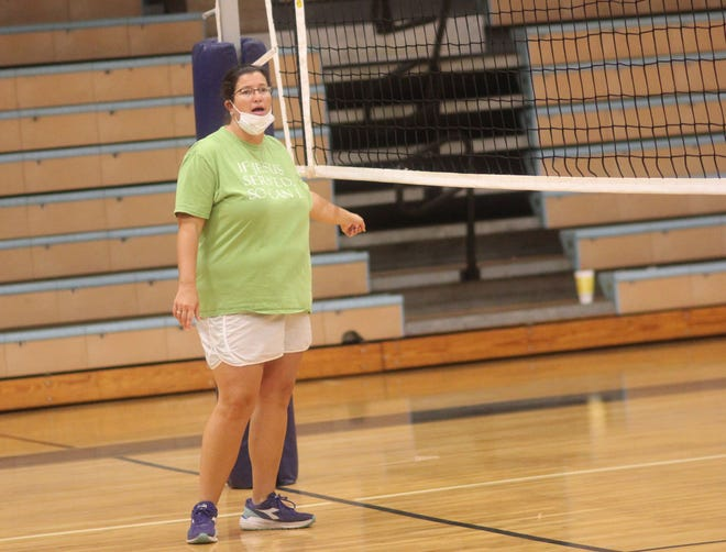 East Duplin volleyball coach Susan Raynor gives instruction to her team during a recent practice. Raynor is back as the Panthers' coach after she stepped down after the 2010 season.