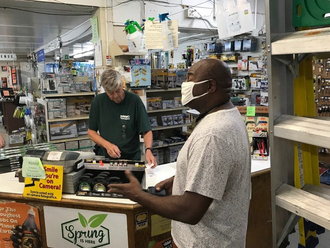 Longtime customer James McCoy, right, chats at Nimmo Hardware, 2329 W. Starr St., a fixture in South Peoria for more than eight decades. At the counter is Dave Campbell, owner for the past 16 years. If a buyer cannot be found by the end of August, the retiring Campbell plans to shutter the business.