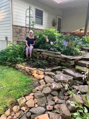 Brenda Harmon in her garden.