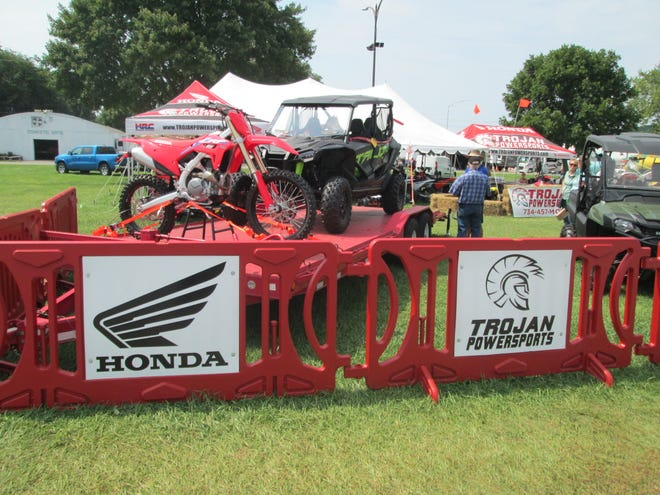 Trojan Powersports of Monroe had the best outdoor exhibit award at the Monroe County Fair for the second time. The business, a Honda Powersportsand Mahindra Tractordealer that featured a  demonstration ride with electric little bikes on a track , also was picked best among trailer and recreational vehicle displays.
