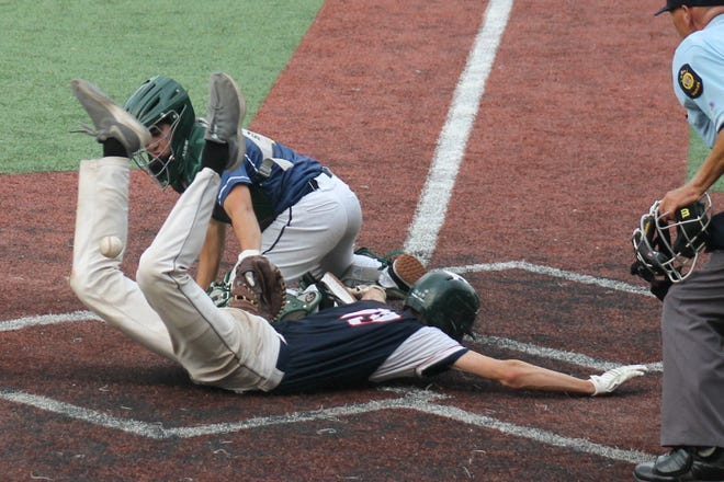 Dover Post 8's David Williams is safe at the plate during Sunday's game against Keene in Jr. Legion state tournament action in Manchester.