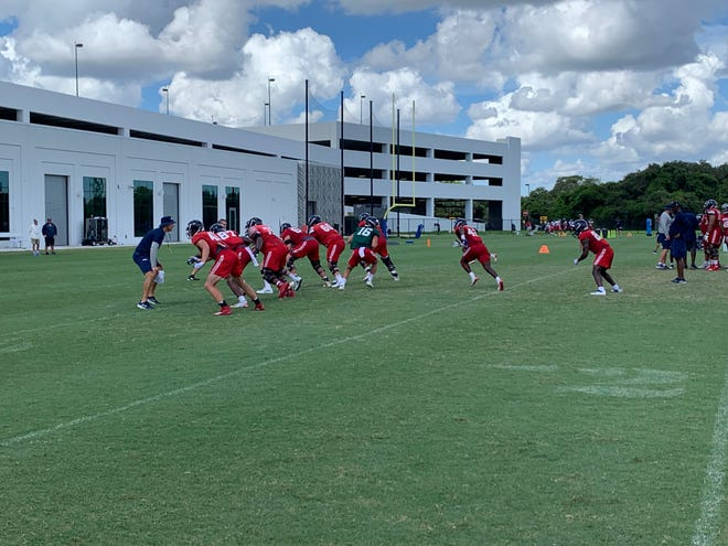FAU quarterback Nick Tronti (16) gets ready to hand off during Monday morning's practice in Boca Raton.