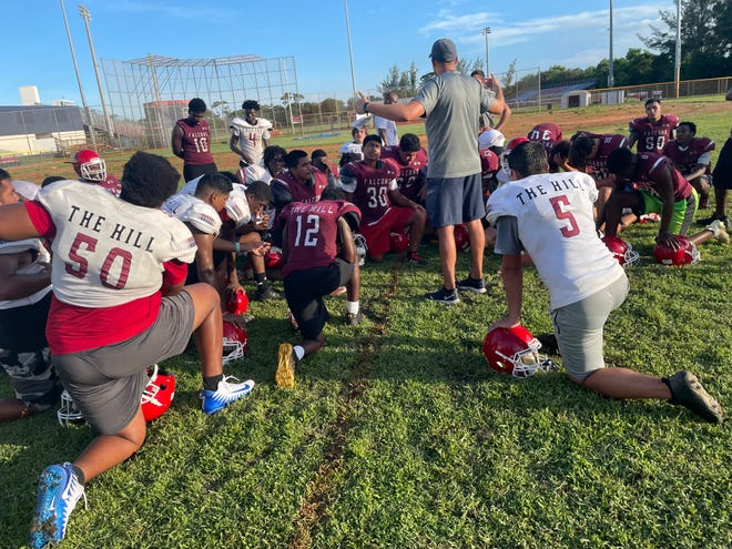 First-year Forest Hill coach Jim Basford talks to his players after practice last week.