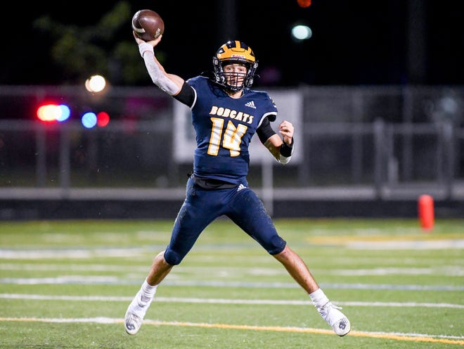 Boca Raton quarterback Jacob Cashion looks for an open receiver during the Bobcats' victory against Coral Springs last December.