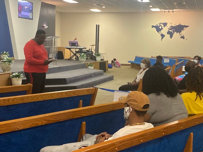 """Bishop Joseph Ford, pastor of Higher Ground International Ministries in Plaquemine, delivers a motivational message to parents during a """"Back to School"""" event."""