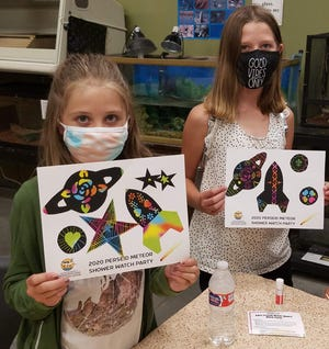 """Participants from the 2020 Perseid Meteor Shower Watch Party show off their """"out of this world"""" craft."""