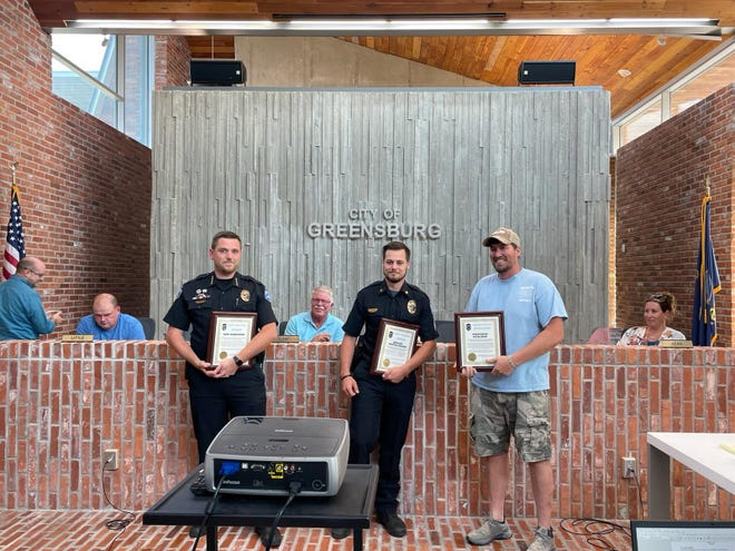 Chief Aaron Webb, officer Preston Capansky, and volunteer fire-fighter Peter Kern were presented with life-saving awards at the Greensburg City Meeting last week.