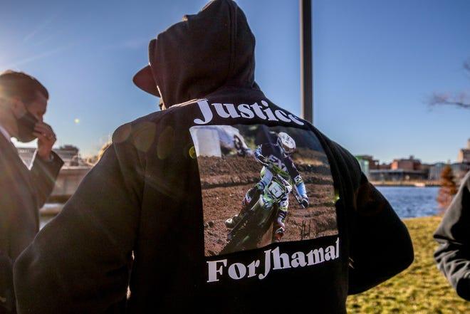 "Jhamal's dad Mark Gonsalves Sr. wears a ""Justice for Jhamal'"" sweatshirt."