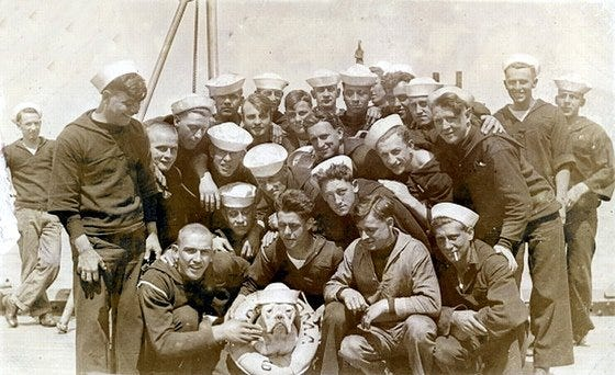 """Sailors aboard the USS Oklahoma pose for a group photo. According to one representative of the Navy's Public Affairs Office, """"it shows that the Oklahoma was more than a ship."""" More than 425 sailors aboard the Oklahoma at the time of the Pearl Harbor attack would lose their lives."""