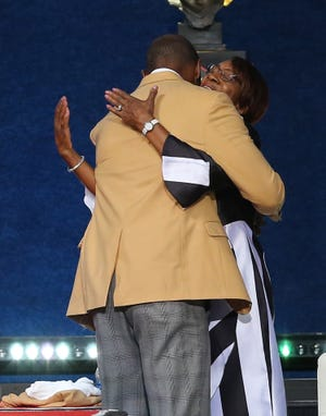 Charles Woodson hugs his mother Georgia Woodson at the conclusion of his Pro Football Hall of Fame Enshrinement speech. Charles Woodson was enshrined in the Pro Football Hall of Fame at Tom Benson Hall of Fame Stadium on Sunday, August 8, 2021. Woodson was presented by his mother Georgia Woodson.