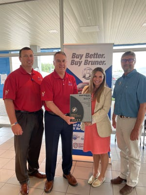 """Bruner GM Stephenville recently received its 2020 Mark of Excellence Award. The """"Mark of Excellence"""" is an award given to dealerships for superior sales and customer satisfaction. The award symbolizes the very pinnacle of success for Buick dealers. According to General Motors, """"Mark of Excellence dealerships are role models for other dealers."""" Pictured from left are Kyle Masters, sales manager; Greg Bruner, president; Westlie Brock, district sales manager; and Mike Melton, general Mmanager."""