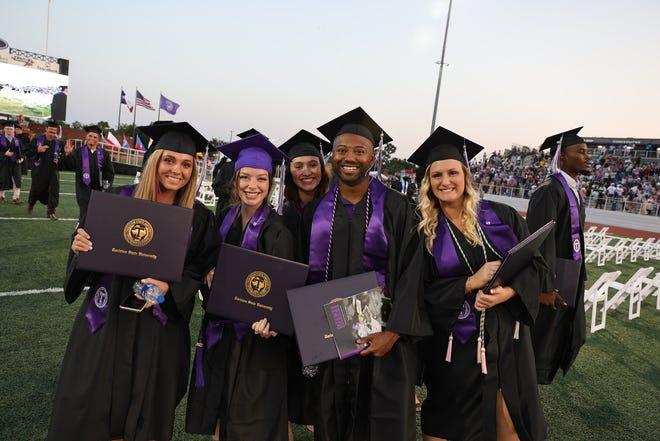 Tarleton graduates show off their diplomas after Friday summer commencement ceremonies at Memorial Stadium.