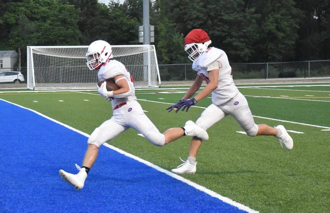 Junior running back Christian McDonald crosses the goal line for the first varsity touchdown on the new turf field.