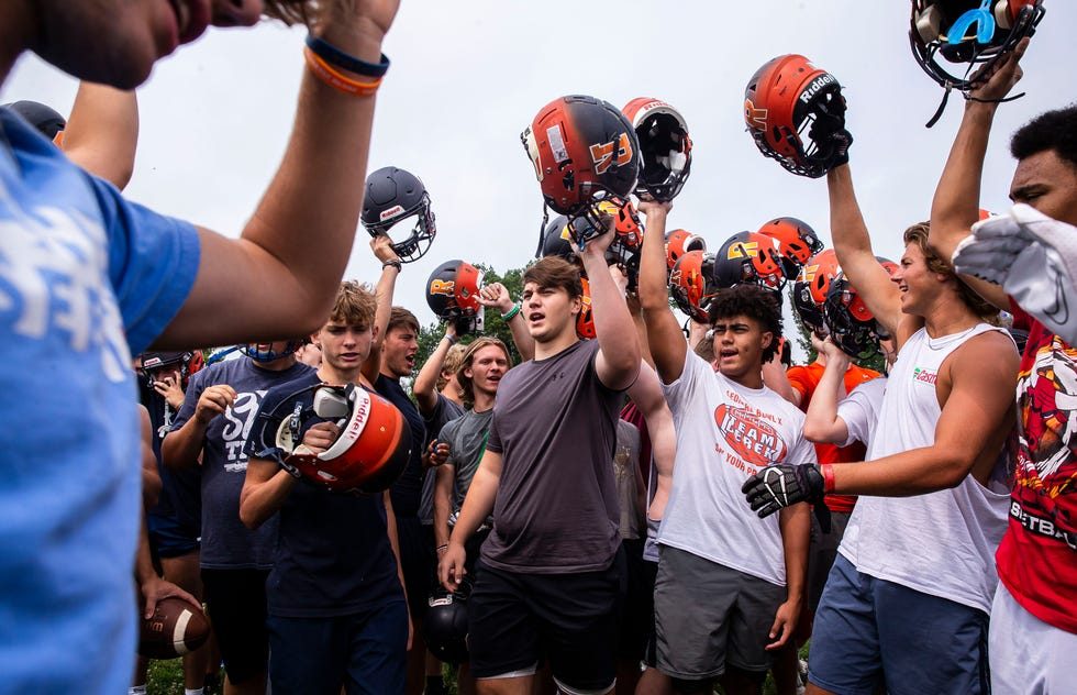 The Rochester Rockets break for the the first day of practice at Rochester High School in Rochester, Ill., Monday, August 9, 2021. The Rockets started the fall season on schedule for the first time since 2019 after the 2020 season was pushed into the spring of this year because of the COVID-19 pandemic.