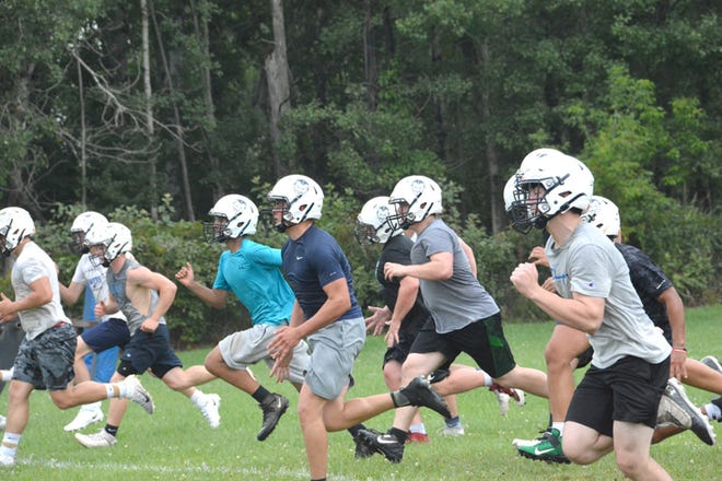 It was the opening day of practice for football teams around the state Monday. Sault High players ran sprints in the morning practice session behind Van Citters Field.