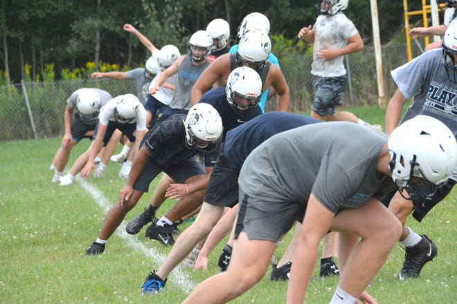 Sault High football players run through drills Monday during the start of two-a-day practices. The Blue Devils' season opener is scheduled for Aug. 27 at St. Ignace.