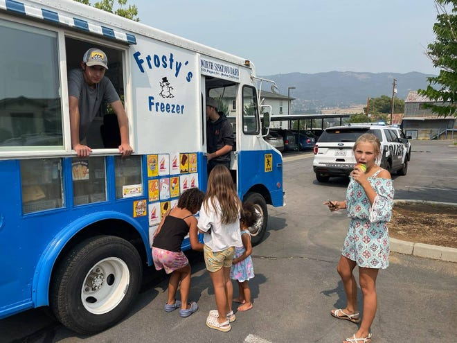 Yreka kids enjoy ice cream provided by the Yreka Police Department on Saturday, Aug. 7.