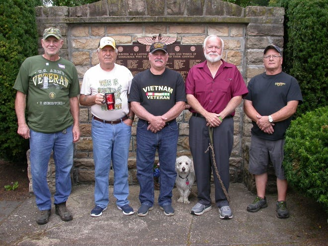 The proposed  memorial to Korea and Vietnam veterans in Confluence will stand beside the World War I and II monument in Confluence Park. From left are: Richard W. Trimpey, Richard Miller, Ron Tressler, Johnny Tressler and Allen Gyorko.