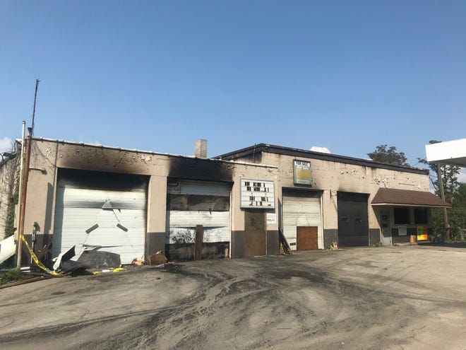 Fire damage is visible above two service bays at the former Miller's service station along route 403 in Hooversville.