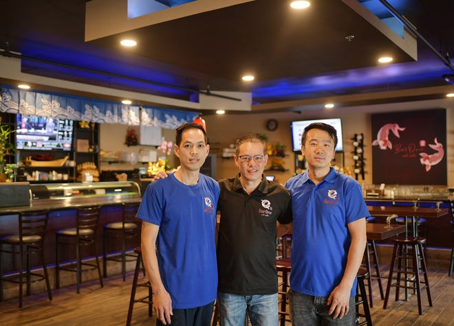 Joe Zheng, Randy Cheah and Chad Wang are the owners of Bar One and sushi, which recently opened in Auburn.