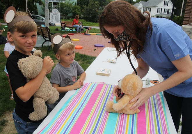 Landon Isgro, 8 and Elliot, 5, of West Boylston, make sure their stuffed pets are in top notch condition during last week's teddy bear clinic at the Beaman Memorial Library, in West Boylston, last week.