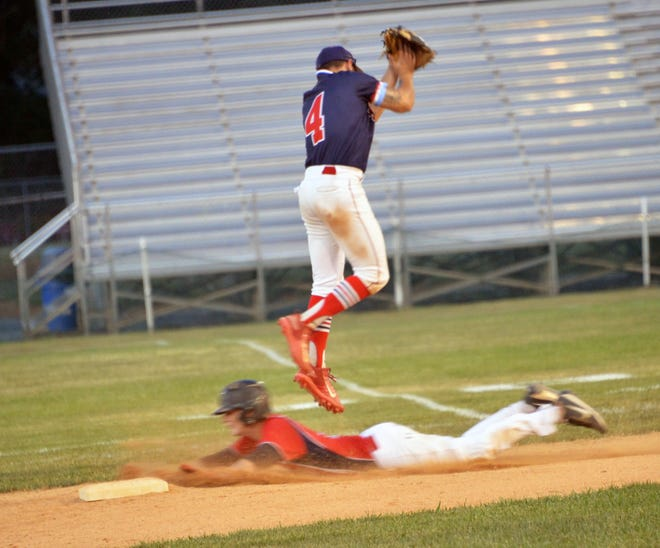Shippensburg's Braden Petty slides under Hagerstown second baseman Justin Lewis, who can't pull down a high throw, for a stolen base during Game 3 of the South Penn Baseball League championship series on Sunday night.