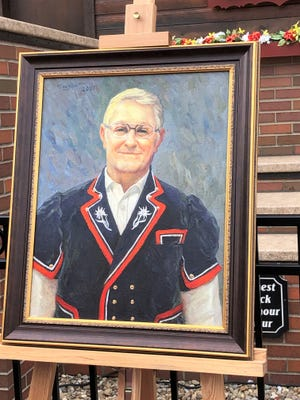 A portrait of Clayton Weller was unveiled Saturday.