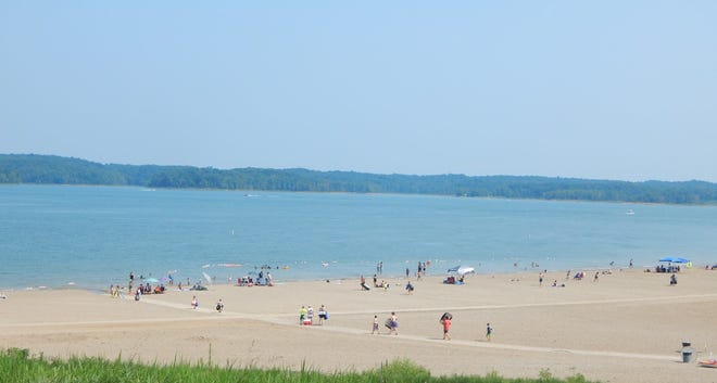 People enjoy the last days of summer at the beach at Patoka Lake. Students have returned to class and the season is winding down, but the lake has seen an increase in visitors this year.