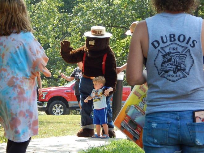 Smokey Bear celebrates his birthday at Patoka Lake Nature Center with photos with the children, cake and refreshments on Aug. 7.