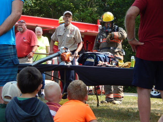 Members of the Southeast District Volunteer Fire Department demonstrate their equipment during Smokey Bear's Birthday at Patoka Lake Nature Center on Aug. 7.
