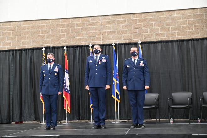 188th Wing's Col. Jeremiah S. Gentry, right, was promoted as the new 188th Wing Commander. Former 188th Wing Commander Leon J. Dodroe, center, is being promoted to brigadier general and commander of the Arkansas Air National Guard to fill the post being left by Brig. Gen. Thomas Crimmins, left. Crimmins has been named the senior defense official and defense attaché to the Kingdom of Saudi Arabia.