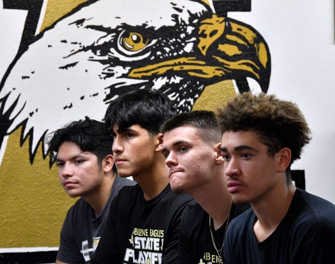 Members of the Abilene High School football team listen as head coach Mike Fullen outlines the commitment required for the upcoming Eagles season Monday.