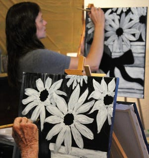 Charlot Ingram begins her sunflowers, following the directions of instructor Kristen Balliew at a painting class July 31 at SunnHaus Brewing Project near Potosi.