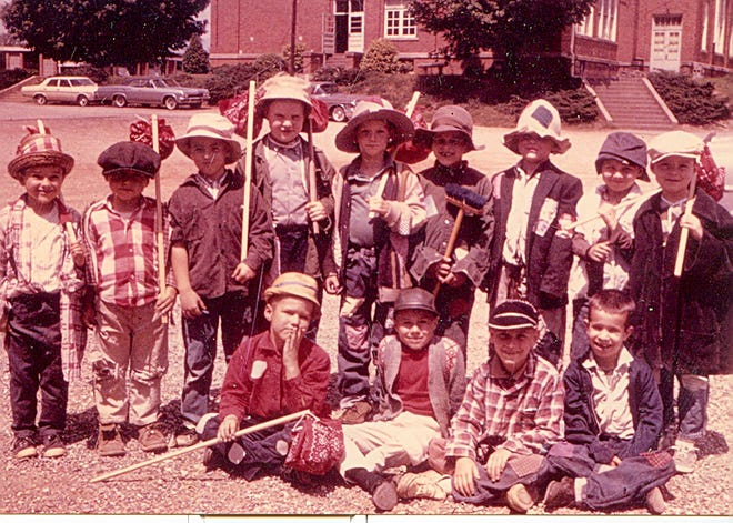 """Henry Mitchell is the tall lad in the back row amid the boys of Miss Warren's first grade class at Oakley School when they participated in a """"King of the Road"""" performance in 1965."""