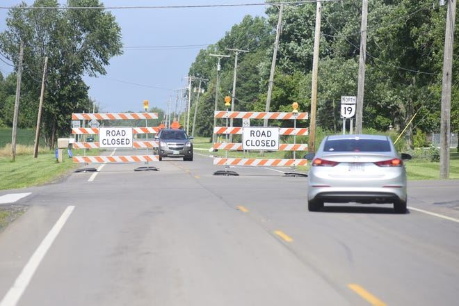 Vehicles navigate the road closure signs on Ohio 19 at the Biddle Road intersection in Galion.
