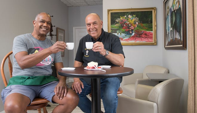 Vincent Amico, right, owner of The Bistro at Vincent's and Vincent's Ice Cream Shop, sits with The Bistro at Vincent's chef and manager Brian Parker, left, inside of The Bistro at Vincent's in Mount Holly.