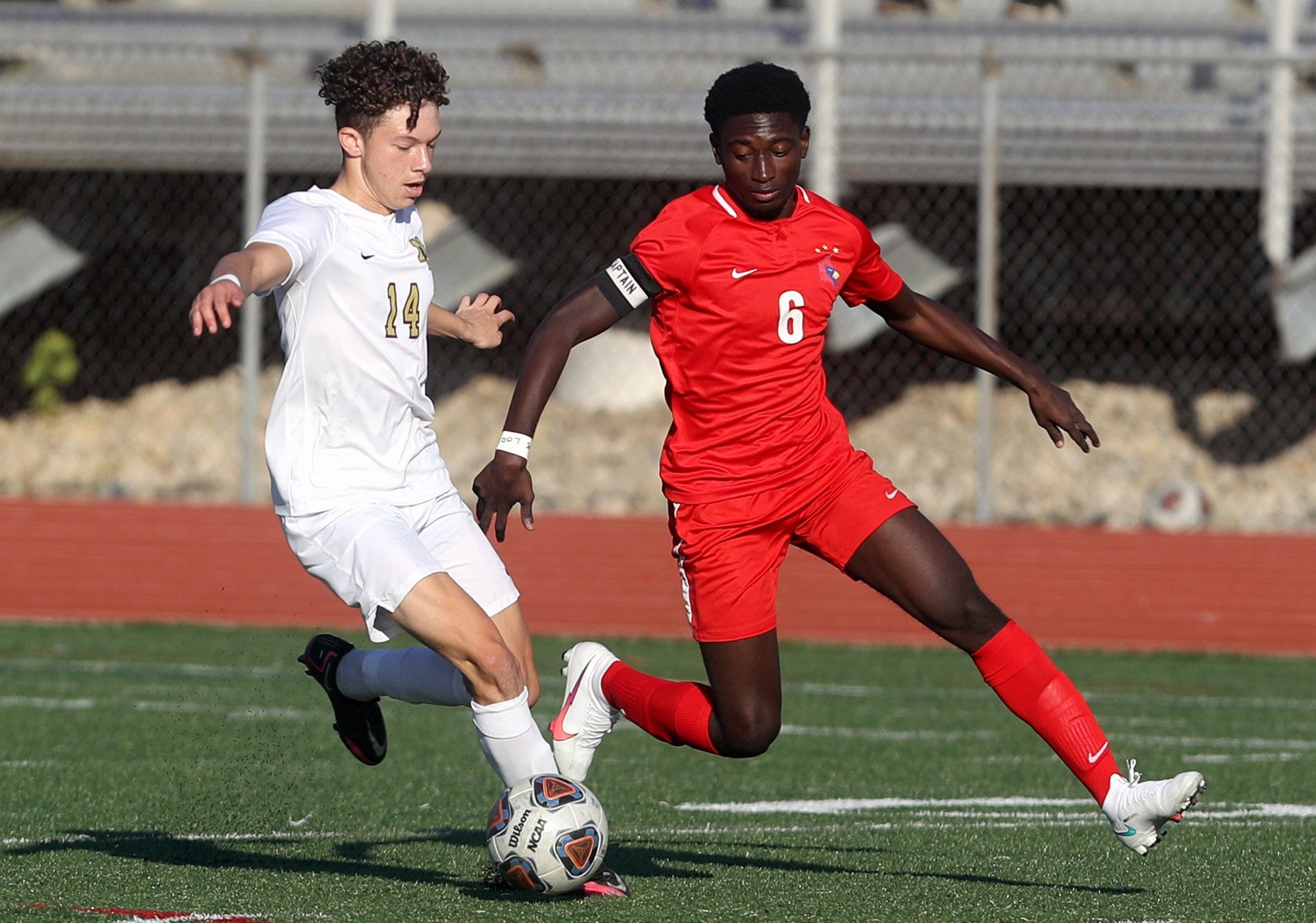 New Albany's Derrick Harris and Thomas Worthington's Caleb Opoku battle for possession during a Division I OHSAA Regional Final game Nov. 7, 2020, at Thomas Worthington High School in Worthington, Ohio.