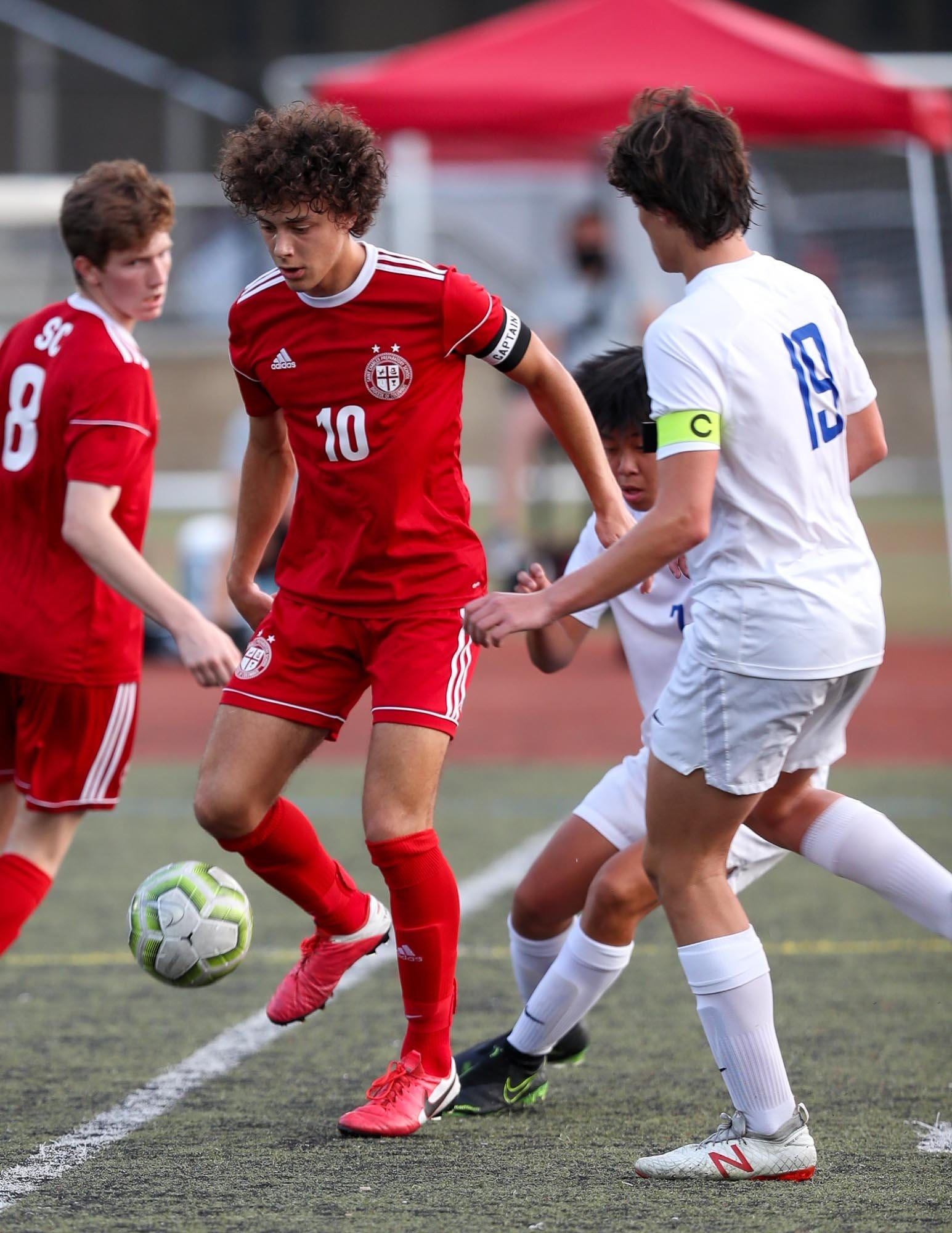 St. Charles player Gabe O'Reilly controls the ball while being defended by Hilliard Davidson's Sam Holden at the St. Charles Preparatory School in Bexley, Ohio on September 10, 2020. The host Cardinals blanked the visiting Wildcats 2-0.