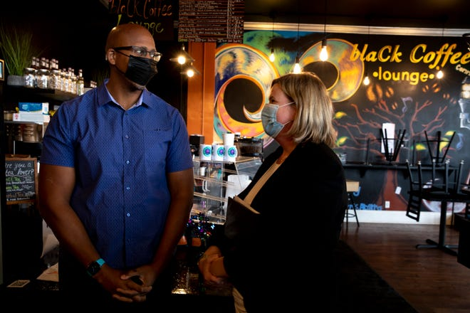 Rob Richardson, left, and Mayor Nan Whaley, Democratic Gubernatorial candidate and Dayton Mayor, speak after a press conference on Monday, Aug. 9, 2021, at BlaCk Coffee Lounge in Cincinnati.