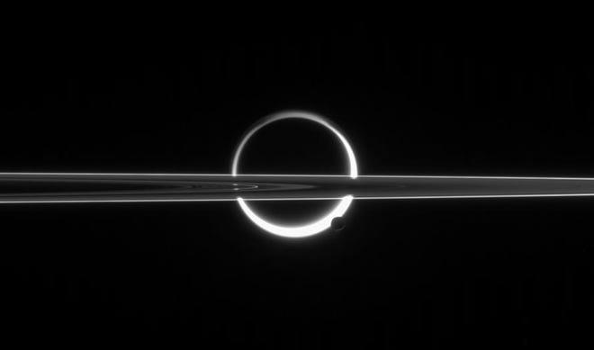 Titan in silhouette by the Cassini spacecraft.