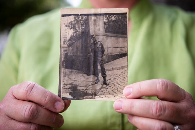 Laura Albrecht, of California, Ky., holds a photo of her great-uncle, Raymond Smith,  one of only two soldiers killed on August 18, 1944, while liberating La Roquebrussanne, a small village in southwest France. Every year since the town has honored their bravery and sacrifice.