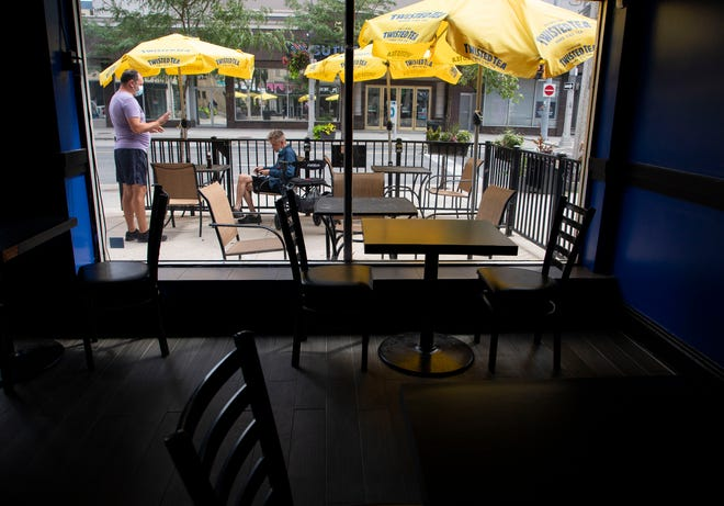 """Zoran Konjicija, a server at the Patio Lounge eatery, takes the order from a customer shortly after opening on Aug. 9, 2021, the first full day of the border re-opening after it had been closed down due to the pandemic.He is hoping the border opening brings back some of the business they lost to the closure and the pandemic, saying, """"I think it's probably going to take a few days or maybe even a couple weeks before it gets busy."""""""