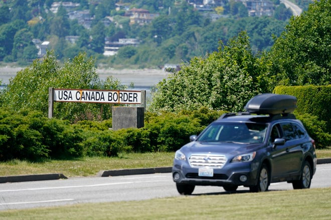 FILE - In this June 8, 2021, file photo, a car heads into the U.S. from Canada at the Peace Arch border crossing in Blaine, Wash. Canada is lifting its prohibition Monday, Aug. 9, on Americans crossing the border to shop, vacation or visit, but the United States is keeping similar restrictions in place for Canadians. The reopening Monday is part of a bumpy return to normalcy from COVID-19 travel bans.  (AP Photo/Elaine Thompson, File)