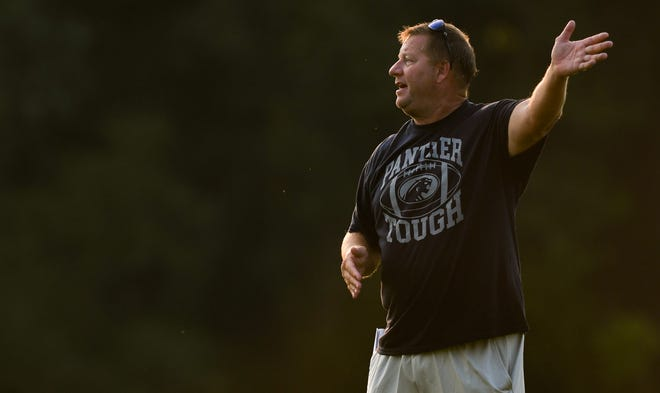 Dewitt head football coach Rob Zimmerman coaches his Panthers Monday Aug. 9, 2021, during the first day of practice.