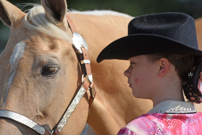 Amiah Noe, 12, of Mansfield, shows her Tennessee walking horse named Madison on Monday morning at the Richland County Fair. Jason J. Molyet/News Journal